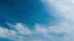 Clouds move across the blue sky Stock Footage