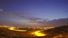 Time lapse of shadow covering Jerusalem's Old City as night falls Stock Footage