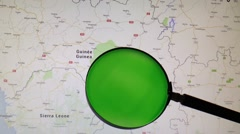 GUINEA seen trough a green magnifying glass Stock Footage