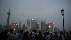 Tourists taking pictures of skyscrapers and cruises seen from the bund Stock Footage