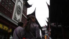 People walking around shopping district of Yuyan garden in Shanghai Stock Footage