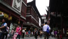 People walking around shopping district of Yuyan garden in Shanghai, China Stock Footage