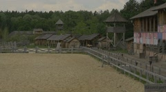 Three Riders Are Moving Around, Forest on Background, Wooden Buildings, Slow Stock Footage