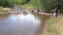 Grandkids race homemade rafts mountain creek 4K Stock Footage