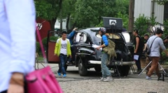 The film crews shooting a car scene at the film studios in Shanghai Stock Footage