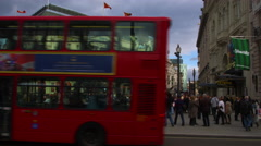 Traffic passing at Piccadilly Circus in London. Stock Footage