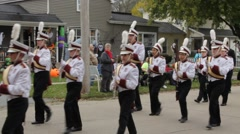 A Marching Band Performs in a Small Town Parade Stock Footage