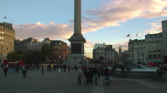 LONDON - OCTOBER 7: Tourists near Nelson's Column in Trafalgar Square at sundown Stock Footage