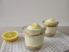 Lemon curd cream cake in glass Stock Photos