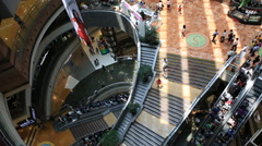 Time lapse of People using luxury shopping mall escalator in Shanghai - stock footage