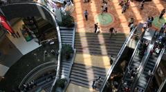 People using luxury shopping mall escalator in Shanghai - stock footage