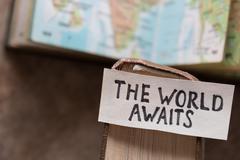 text The World Awaits - stock photo