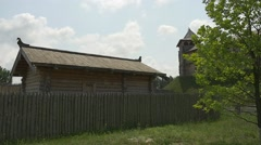 Wooden Ancient House Behind The Log Fence, Watchtower on the Hill Stock Footage