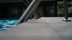 Girl jumping in pool Stock Footage