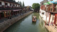 Beautiful landscape of a tour boat on river of suburb Shanghai city, Zhujiajiao Stock Footage