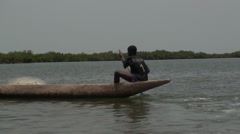 Dugout and children in bollongs in the senegal Stock Footage