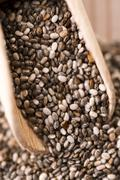 Nutritious chia seeds on a wooden spoon Stock Photos