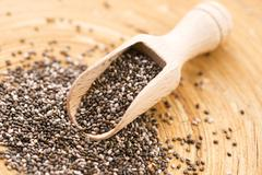 Nutritious chia seeds on a wooden spoon - stock photo