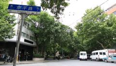 Time lapse of street view of dongping road (Dongping Lu) in Shanghai Stock Footage