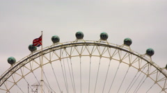 London Eye capsules and British flag Stock Footage