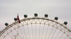 British flag and London Eye capsules Stock Footage