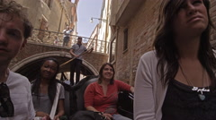 Rear-facing view in gondola facing toward people and gondolier Stock Footage