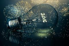 Stock Illustration of Composite image of colourful fireworks exploding on black background
