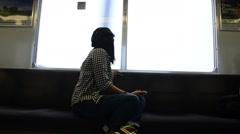 Thai women on Rapid train at Numba station go to Kansai Airport in Osaka, Japan Stock Footage