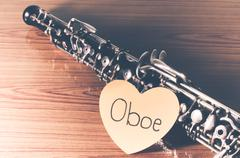 Oboe on wood background Stock Photos