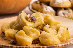 Homemade pumpkin gnocchi with pecan nuts Stock Photos
