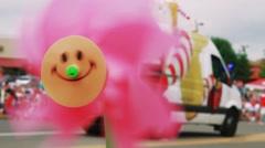 Slow Motion spinning pinwheel Stock Footage