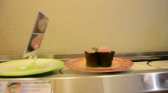 Conveyor belt sushi or Sushi-go-round or sushi train Stock Footage