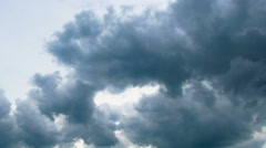 Storm clouds moving across the blue sky Stock Footage