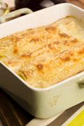 Leeks casserole with white sauce and cheese Stock Photos