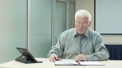 Stock Video Footage of 4k, Chief signs the documentstablet on the table  2