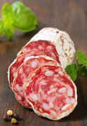 Sliced Saucisson Sec - French dry sausage Stock Photos