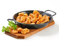 Crispy fried pork greaves in a skillet Stock Photos