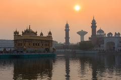 Sikh gurdwara Golden Temple (Harmandir Sahib) on sunrise. Amritsar, Punjab - stock photo