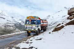 Manali-Leh road in Indian Himalayas with lorry. Himachal Pradesh, India - stock photo
