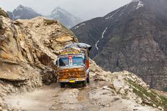Manali-Leh road in Indian Himalayas with lorry. Himachal Pradesh, India - stock photo