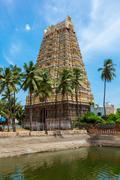 Gopura (tower) and temple tank of Lord Bhakthavatsaleswarar Temple. Built by  Stock Photos