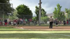 Softball game rural community out at first 4K Stock Footage