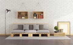 Living room with pallet sofa - stock illustration