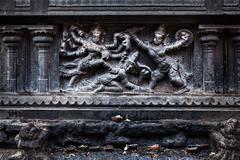 Bas relief depicting Durga slaying demon (Maheeshasuramardini). Brihadishwara - stock photo