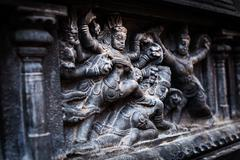 Bas relief depicting Durga slaying demon (Maheeshasuramardini). Brihadishwara Stock Photos