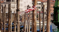 Slow motion shot of wooden docking posts for gondolas Stock Footage