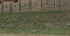 Walls of Ancient Sity on the Green Hill, Wooden Structures, Palisade, Fortress Stock Footage