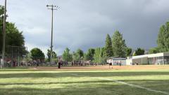 Softball game rural community third base hit 4K Stock Footage
