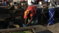 Seller of fish on the beach of Dakar Stock Footage