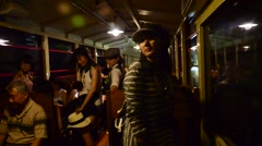 Traveler on Sagano Scenic Railway in tunnel at Arashiyama in Kyoto, Japan Stock Footage